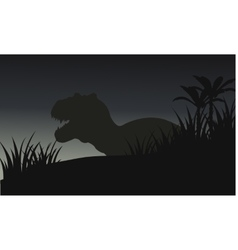 Silhouette of big tyranosaurus with grass vector