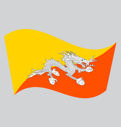 Flag of bhutan waving on gray background vector
