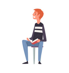young man sitting on chair and reading book vector image