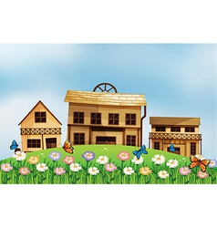 Three different wooden houses at the hill vector image