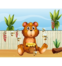 A bear with five bees vector image