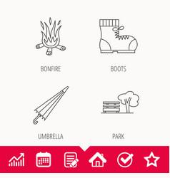 Bonfire umbrella and hiking boots icons vector