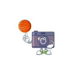 A strong retro camera cartoon with a basketball vector