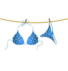 bikini suit with white dots hanging on rope vector image