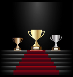 gold silver and bronze trophy cuppodium with red vector image