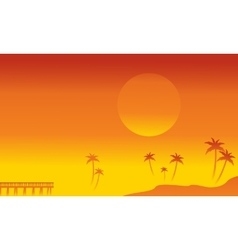 Silhouette of palm and pier vector