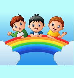 Cartoon happy kids on the rainbow vector