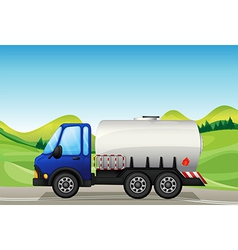 An oil tanker near the hills vector image vector image
