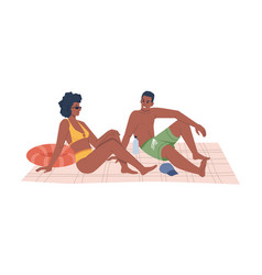 couple in swimsuits sitting on blanket on beach vector image