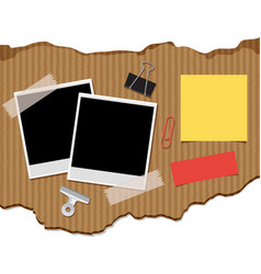 Two photoframes and notepads on cardboard vector
