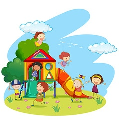 Children playing on slide in park vector image vector image
