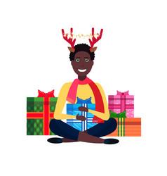 african american man deer horns sitting lotus pose vector image