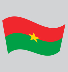 Flag of burkina faso waving on gray background vector