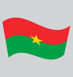 Flag of burkina faso waving on gray background vector