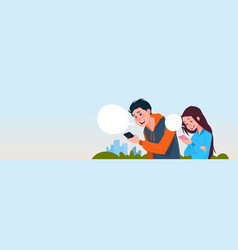young boy and girl messaging outdoors holding cell vector image