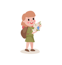 Flat girl scout studying tourist map and backpack vector