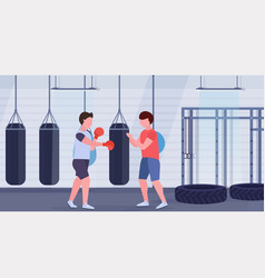 man boxer with personal trainer hitting punching vector image