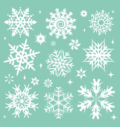 white snowflakes icon on green background vector image