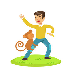 cute happy boy standing and playing with monkey vector image