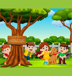 happy children are playing near the big tree vector image
