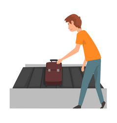 young man picking up his suitcase on luggage vector image