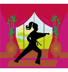 Young woman training karate vector