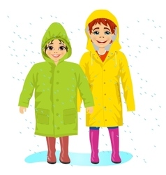 Brother and sisiter wearing raingcoats vector