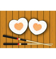 Heart-shaped sushi and chopsticks vector image