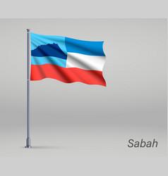 Waving flag sabah - state malaysia on vector