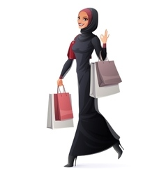 Muslim woman walking with shopping bags and vector image vector image