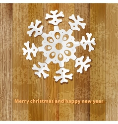 White paper christmas snowflake on a wood EPS8 vector image vector image