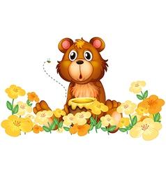 A bear with a honey at the garden vector image