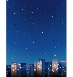 Buildings in the city at night vector