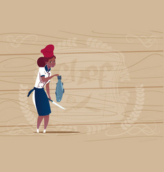 female african american chef cook holding fish vector image