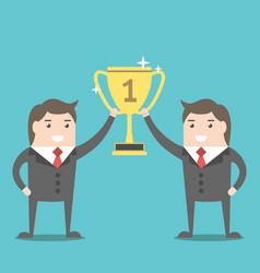 businessmen holding winner cup vector image