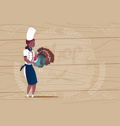 female african american chef cook holding turkey vector image