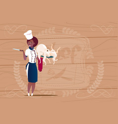 female african american chef cook holding octopus vector image