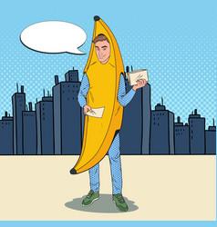 Pop art man in banana costume promoting something vector