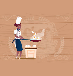 Female african american chef cook frying eggs vector