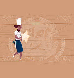Female african american cook holding star best vector