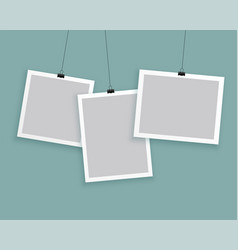 Hanging photo frames in different sizes background vector