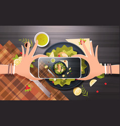 food blogger taking mobile photo of fresh vector image
