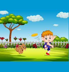boy are playing frisbee with his dog vector image