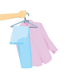 hand holding pants and shirt on hangers vector image