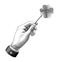 hand hold clover leaf drawing vintage style black vector image