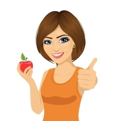 beautiful woman with red apple showing thumbs up vector image
