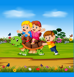 Three children are playing on the big turtle vector