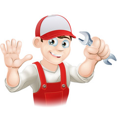 Happy plumber or mechanic with spanner vector