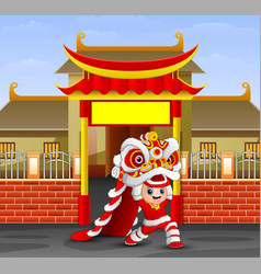 kid playing chinese dragon dance in front of the t vector image