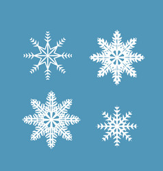 set of 4 snowflakes on a blue background vector image vector image